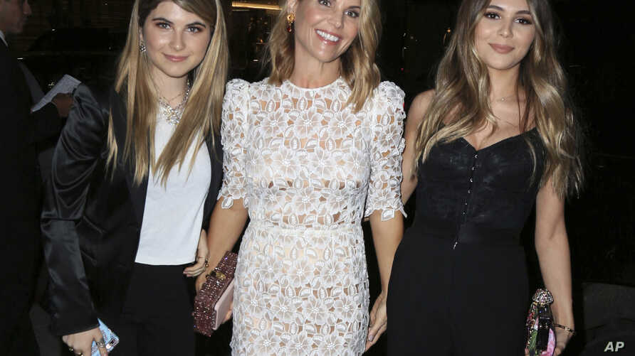 Actress Lori Loughlin, center, is seen with her daughters Isabella Rose Giannulli and Olivia Jade Giannulli in Los Angeles, Calif.