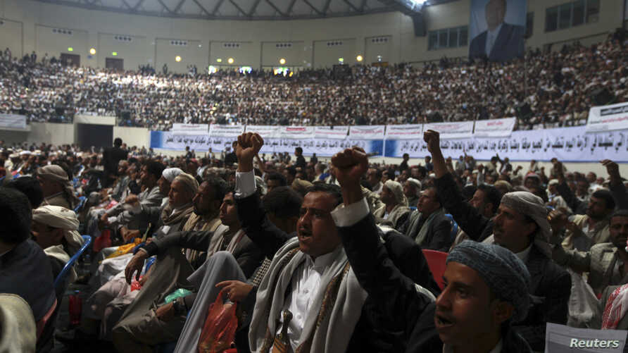 People shout slogans during a tribal gathering organized by the Shi'ite Houthi movement in Sanaa, Yemen, Oct. 31, 2014.