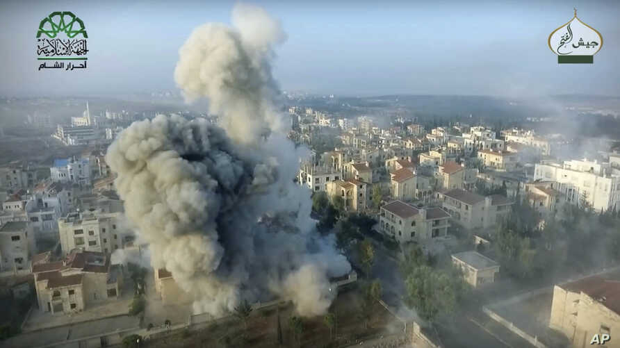 This image posted online by the Ahrar al-Sham militant group purports to show a blast on the ground in a neighborhood of Aleppo, Syria. Syrian government forces launched a counteroffensive Oct. 29, 2016, under the cover of airstrikes to regain contro