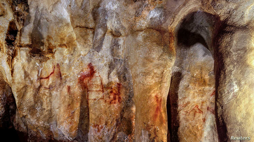 Neanderthal paintings can be seen in a cave in Pasiega, Spain in this photo obtained Feb. 22, 2018. University of Southampton.