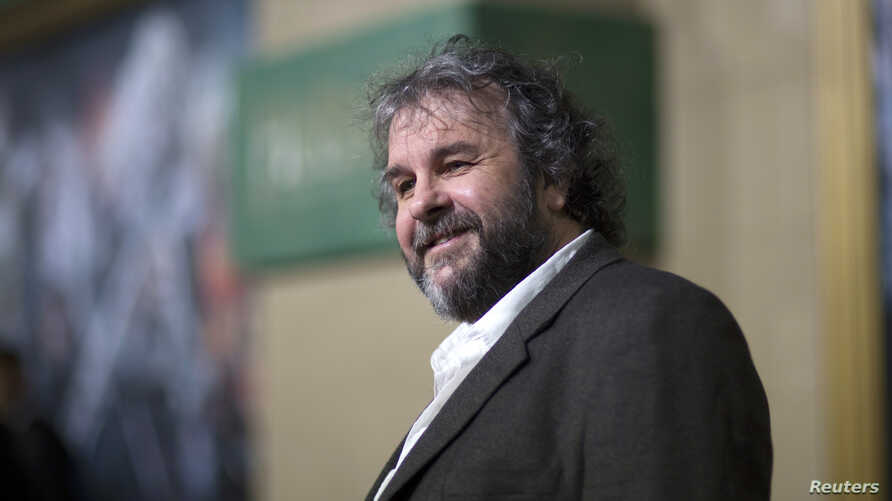 """FILE - Writer, producer and director Peter Jackson poses at the premiere of """"The Hobbit: The Battle of the Five Armies"""" at Dolby theatre in Hollywood, California, Dec. 9, 2014."""