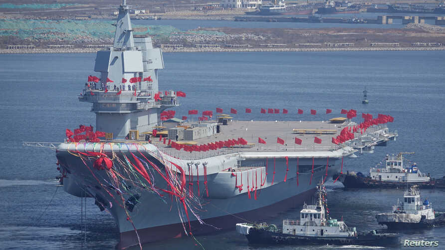 China's first domestically built aircraft carrier is seen during its launching ceremony in Dalian, Liaoning province, China, April 26, 2017.