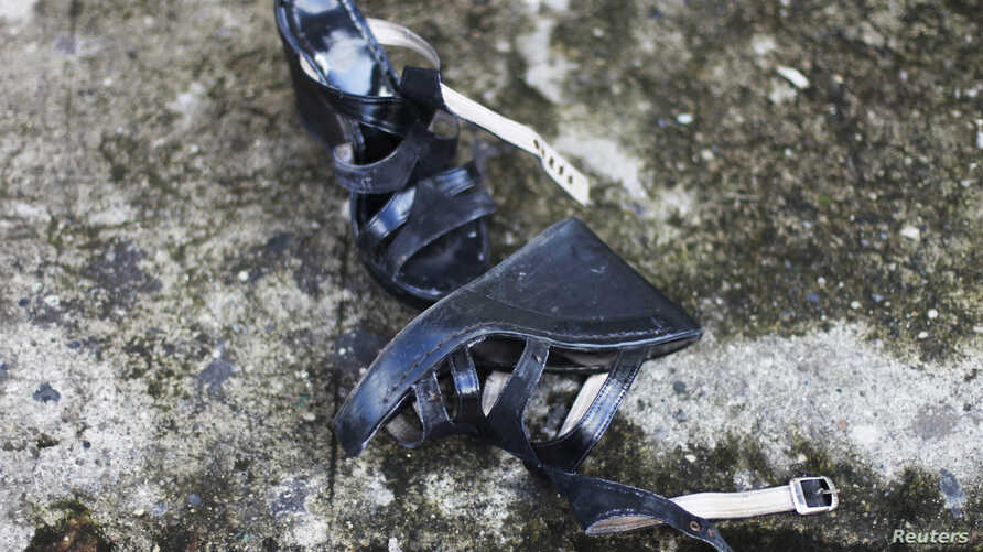 FILE - A woman's shoes lie on a street in Quezaltepeque July 2, 2013. Central America encompasses some of the countries with the world's highest rates of femicide,