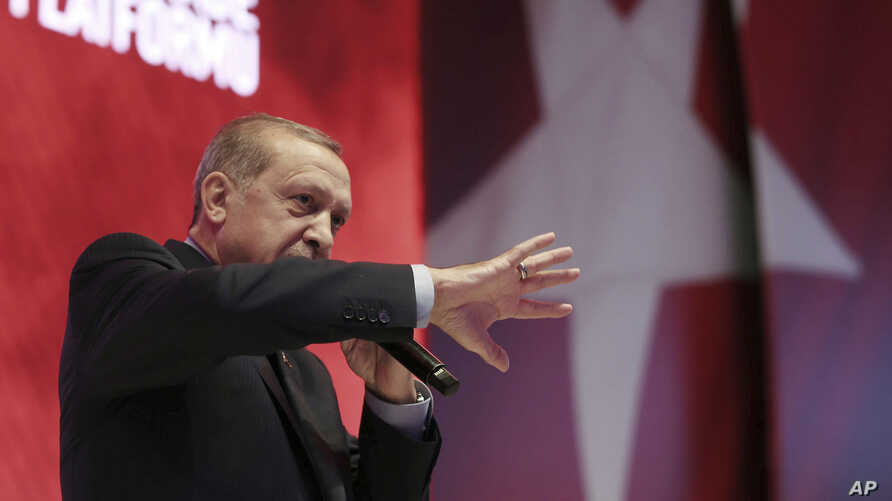 Turkey's President Recep Tayyip Erdogan addresses his supporters during a referendum meeting in Istanbul, April 12, 2017.