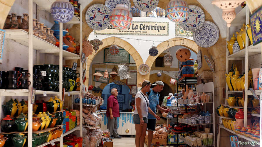 Russian tourists are seen shopping at the old medina in Sousse, Tunisia, Sept. 30, 2017.