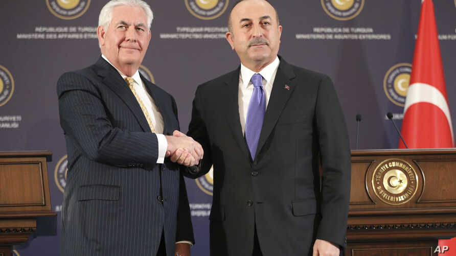 Turkey's Foreign Minister Mevlut Cavusoglu, right, shakes hands with U.S. Secretary of State Rex Tillerson, left, after a joint news conference following their meeting in Ankara, Turkey, Feb. 16, 2018.