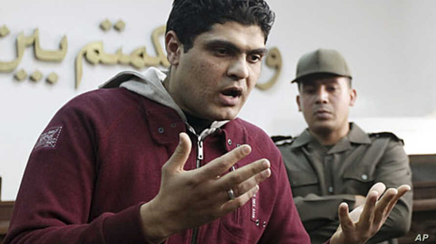 Army doctor Ahmed Adel, who was accused of carrying out a forced virginity test on a female detainee, speaks to the media after being acquitted in Cairo March 11, 2012.