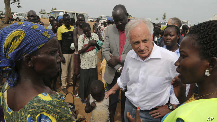 U.S. Sen. Bob Corker, center, speaks to recent refugees from South Sudan at a registration center in Bidi Bidi, Uganda, April 14 2017. Corker, the Republican chairman of the Foreign Relations Committee, defended U.S. foreign assistance while visiting