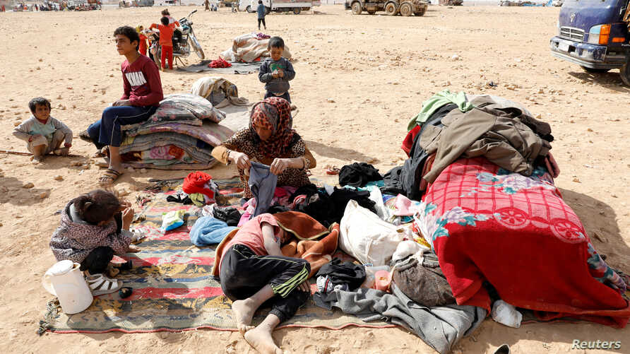 People displaced in fightings between the Syrian Democratic Forces and Islamic State militants are pictured at a refugee camp in Ain Issa, Syria, Oct. 14, 2017.