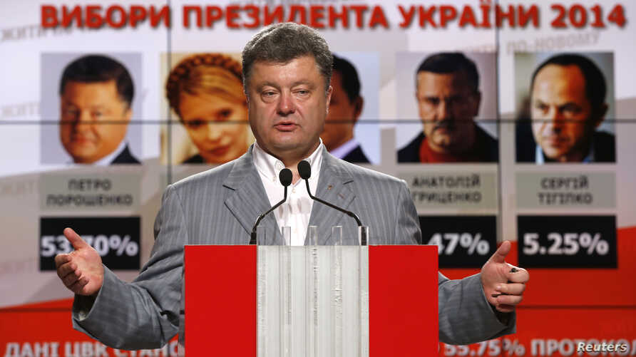 Ukrainian businessman, politician and presidential candidate Petro Poroshenko speaks during his news conference in Kyiv, May 26, 2014.