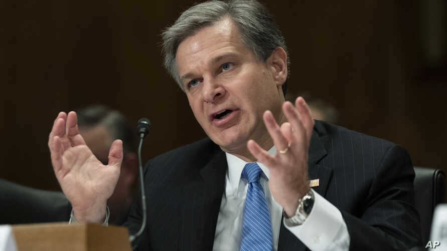 FBI Director Christopher A. Wray, testifies during a hearing of the Senate Committee on Homeland Security & Governmental Affairs, on Capitol Hill, Oct. 10, 2018, in Washington.
