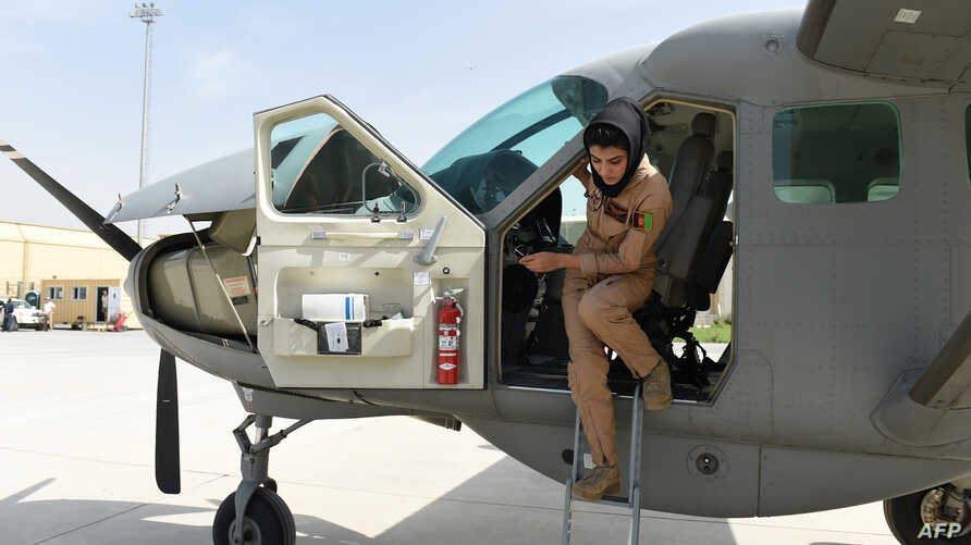 FILE -  In a picture taken on Apr. 26, 2015, Afghanistan's first female pilot Niloofar Rahmani, 23, exits a fixed-wing Afghan Air Force aviator aircraft in Kabul.