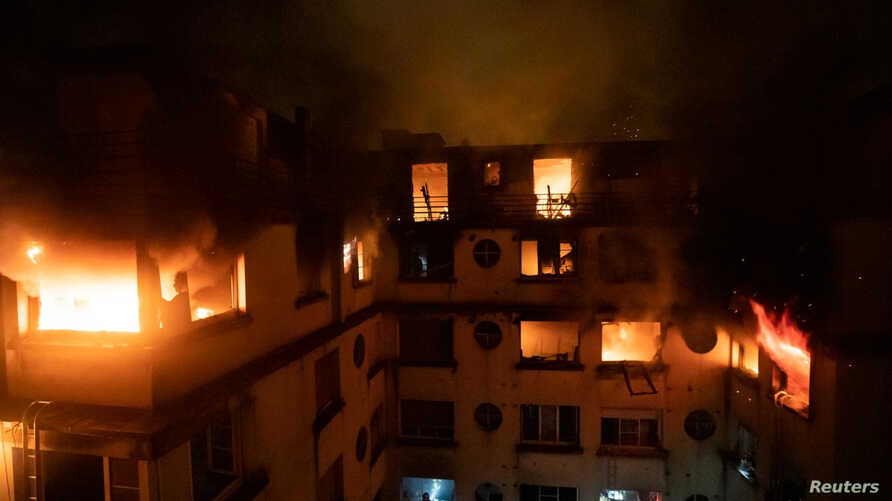 A residential building is engulfed in flames in Paris, France Feburary 5, 2019 in this image obtained from social media. (B. Moser/Brigade des Sapeurs-Pompiers de Paris (BSPP) via Reuters)