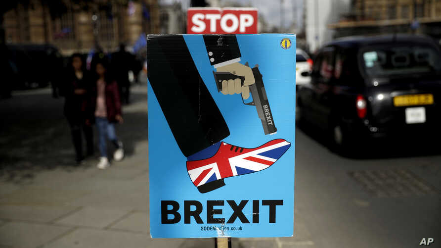 APTOPIX Britain BrexitPlacards placed by anti-Brexit supporters stand opposite the Houses of Parliament in London, March 18, 2019.