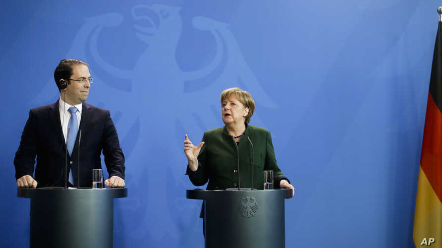 German Chancellor Angela Merkel, right, and Tunisian Prime Minister Youssef Chahed brief the media after talks at the chancellery in Berlin, Feb. 14, 2017.
