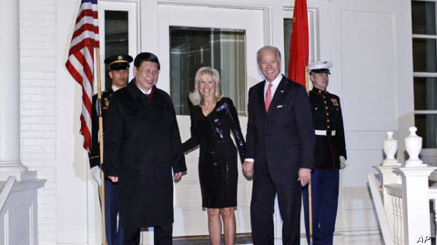 Vice President Joe Biden and Jill Biden welcome Chinese Vice President Xi Jinping to a dinner at the Naval Observatory in Washington, Tuesday, Feb. 14, 2012.