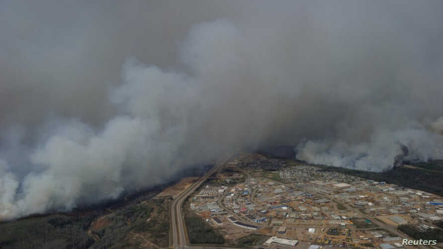 A Canadian Joint Operations Command aerial photo shows wildfires near neighborhoods in Fort McMurray, Alberta, Canada in this image posted on twitter on May 5, 2016, courtesy CF Operations.