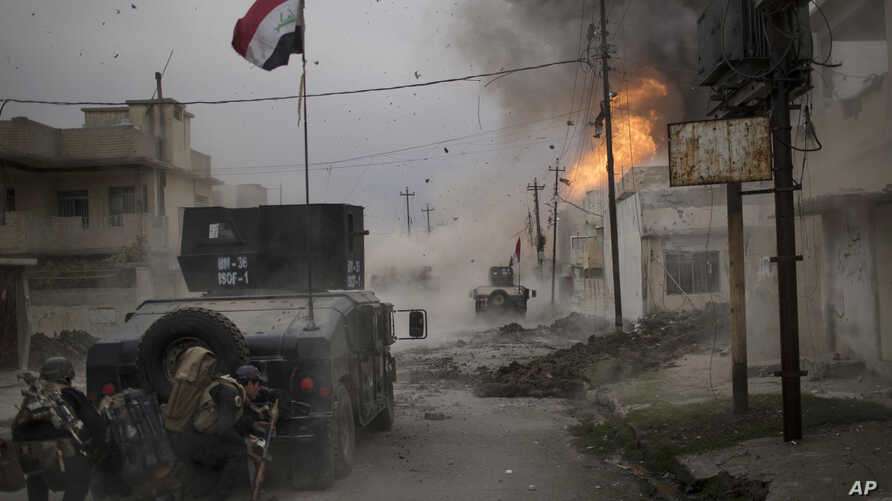 A car bomb explodes next to Iraqi special forces armored vehicles as they advance towards Islamic State held territory in Mosul, Iraq, Nov. 16, 2016.