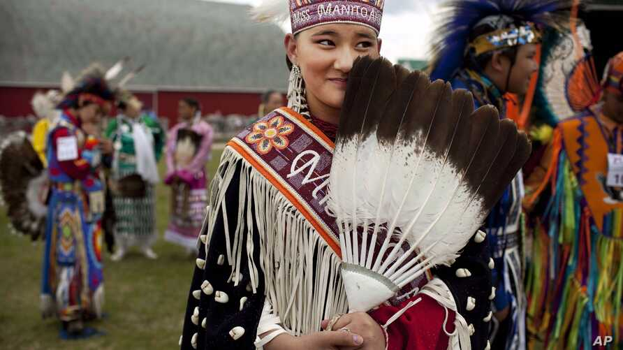 FILE - A young woman from the Lakota nation wears traditional clothing at an event celebrating National Aboriginal Day in Winnipeg, Manitoba, June 21, 2011.