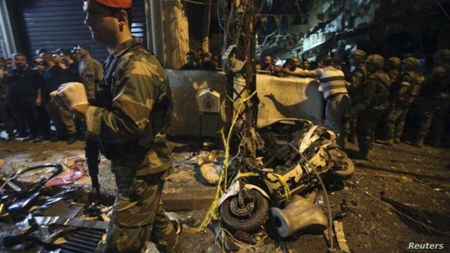 Residents and Lebanese army members inspect a damaged area caused by two explosions in Beirut's southern suburbs, Lebanon November 12, 2015.