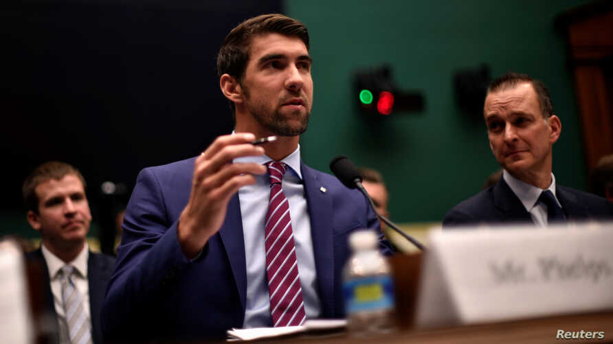 Olympic gold medalist Michael Phelps testifies before the House Oversight and Investigations Subcommittee about anti-doping policy in international sport as U.S. Anti-Doping Agency CEO Travis Tygart, right, looks on in Washington, Feb. 28, 2017.