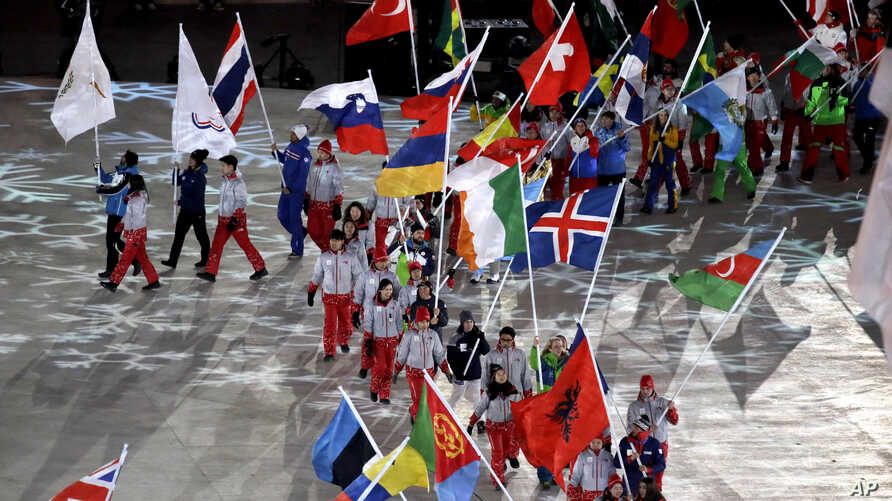 Athletes walk into the stadium during the closing ceremony of the 2018 Winter Olympics in Pyeongchang, South Korea, Feb. 25, 2018.