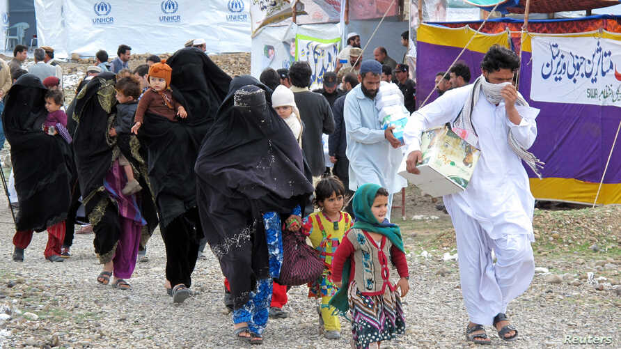 FILE - Internally Displaced Persons from South Waziristan leave for their hometown from Kawr camp in Pakistan's northwestern town of Tank, March 16, 2015.