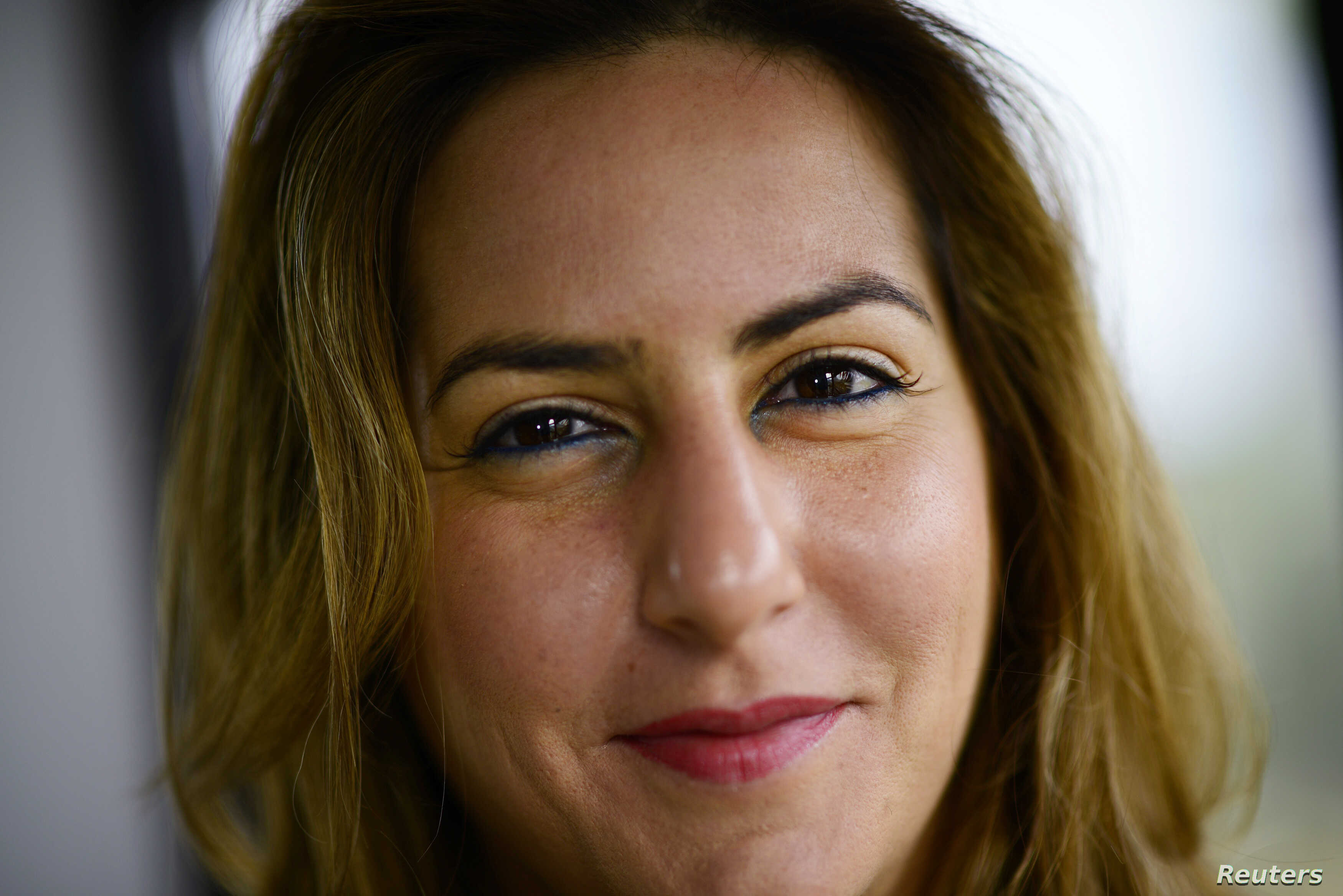 Karma Khayat of Lebanon poses for a photograph during an interview with Reuters in London, March 16, 2015.