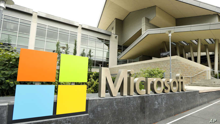 FILE - Microsoft Corp. signage is seen outside the Microsoft Visitor Center in Redmond, Washington, July 3, 2014.
