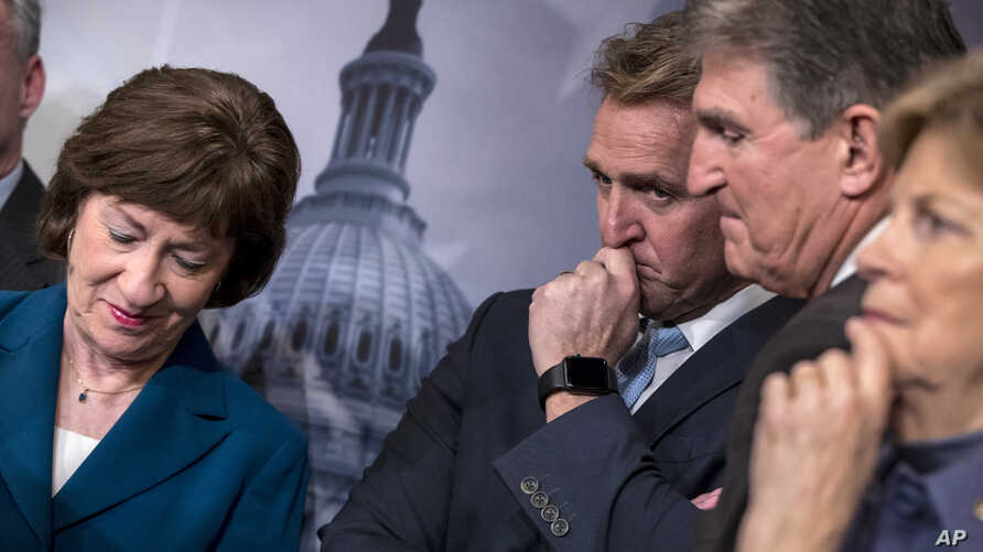 From left, Sen. Susan Collins, R-Maine, Sen. Jeff Flake, R-Ariz., Sen. Joe Manchin, D-W.Va., and Sen. Jeanne Shaheen, D-N.H., finish a news conference on the bipartisan immigration deal they reached, during a news conference at the Capitol in Washing