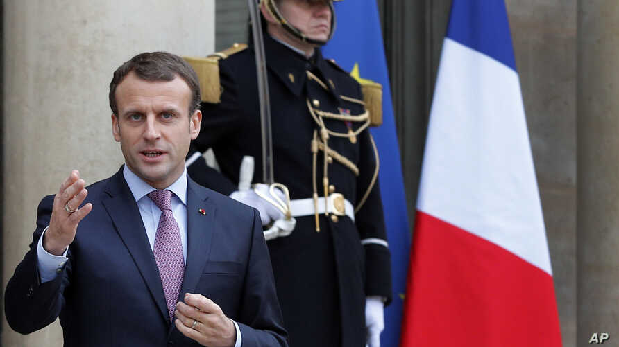 French President Emmanuel Macron arrives to adress reporters after a meeting with his Bulgarian counterpart Rumen Radev at the Elysee Palace, in Paris, France, Dec. 4, 2017.