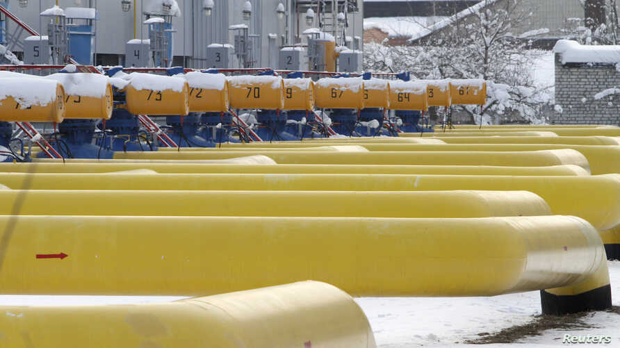 Pipes are seen at a gas compressor station in the village of Boyarka, outside Kyiv, Ukraine, Dec. 19, 2012.