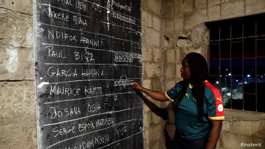 An election worker counts votes during the presidential election in Yaounde, Cameroon, Oct. 7, 2018.
