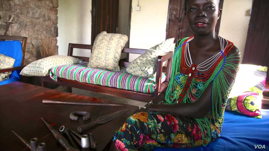 South Sudanese fashion designer and anthropologist Akuja de Garang hopes to promote the country's bullet blacksmiths and others using shell casings to make spears, pipes and jewelry before such skills are lost.  (H. McNeish for VOA)
