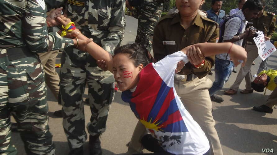 At a demonstration in front of the Chinese Embassy in New Delhi, police arrested 150 Tibetan youth activists marking the 58th anniversary of China's presence in Tibet, March 10, 2017. (T. Wangyal/VOA)