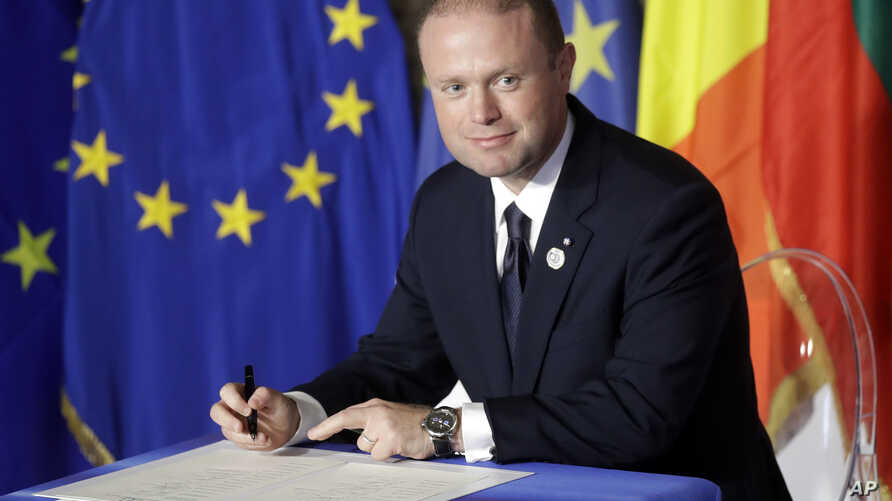 FILE - Malta's Prime Minister Joseph Muscat signs a declaration during an EU summit meeting in the Palazzo dei Conservatori in Rome, March 25, 2017. Malta's Prime Minister Joseph Muscat called elections for June 3, a year early, to test his popularit