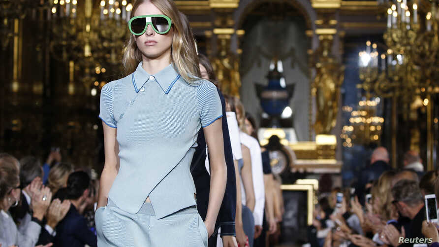 FILE - A model presents a creation by British designer Stella McCartney as part of her Spring/Summer 2016 women's ready-to-wear fashion show in Paris, France.