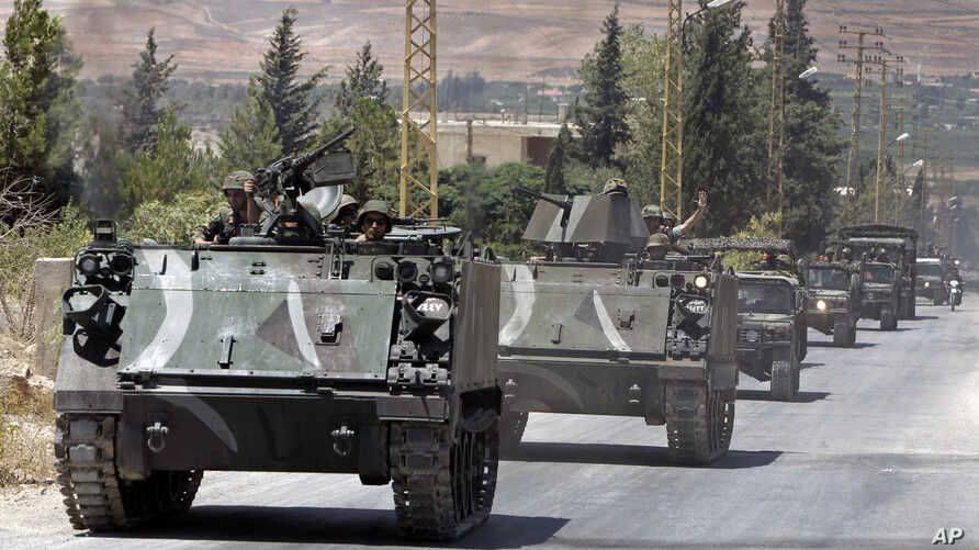 Lebanese army reinforcements arrive to the outskirts of Arsal, a predominantly Sunni Muslim town near the Syrian border in eastern Lebanon, Aug. 4, 2014.