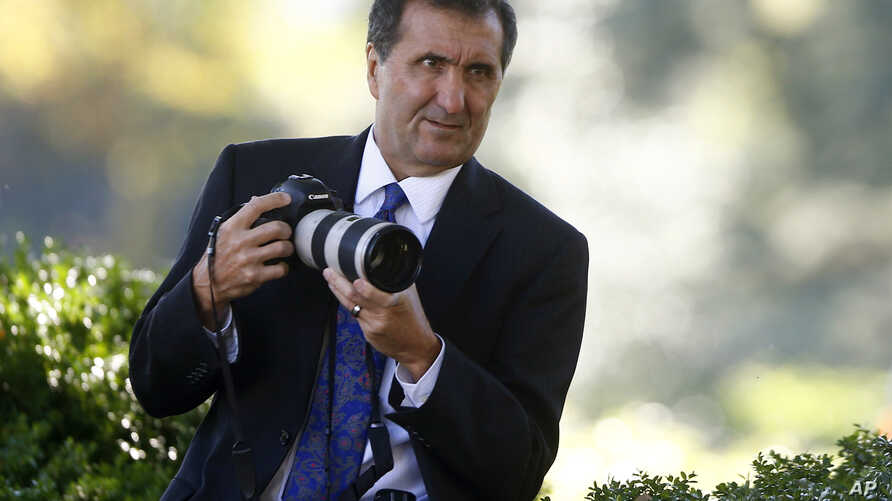 FILE - A photo shows official White House photographer for then president Barack Obama, Pete Souza, during an event in the Rose Garden of the White House in Washington, Oct. 21, 2013.