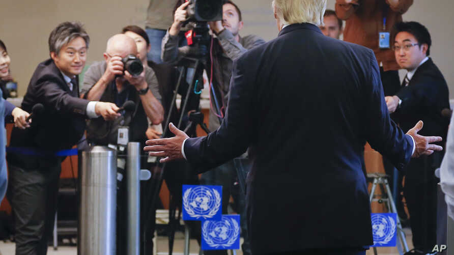 President Donald Trump makes a brief statement to the media as he leaves after addressing a meeting at U.N. headquarters, Sept. 18, 2017.