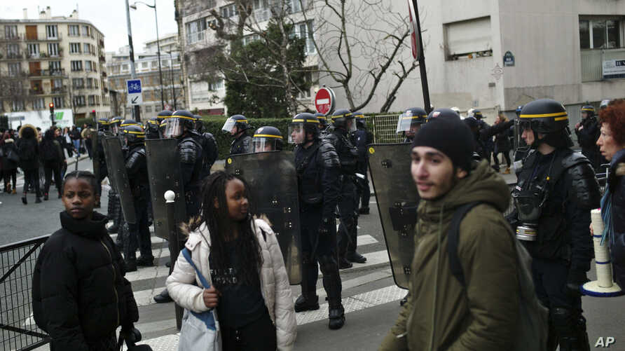 Students protest against alleged police abuses in front of Henri Bergson College, in Paris, France, Feb. 23, 2017.
