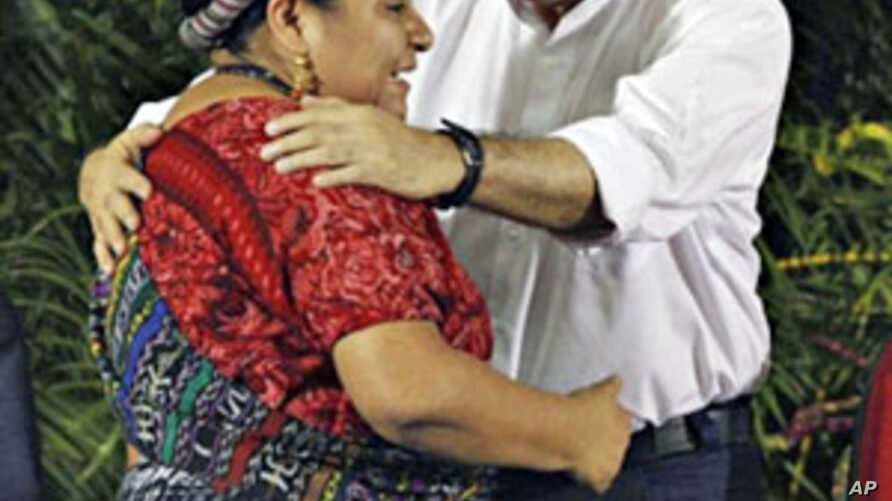 Nicaraguan President Daniel Ortega greets to Nobel Peace Prize recipient, Guatemalan indigenous leader Rigoberta Menchu, during a ceremony starting the school year in the country in Ciudad Sandino, about 17 kms west Managua, February 15, 2011