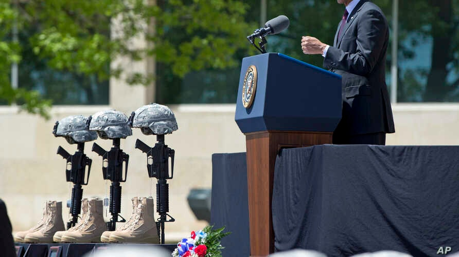 President Barack Obama speaks during a memorial ceremony at Fort Hood, Texas, for those killed there in a shooting last week, April 9, 2014.