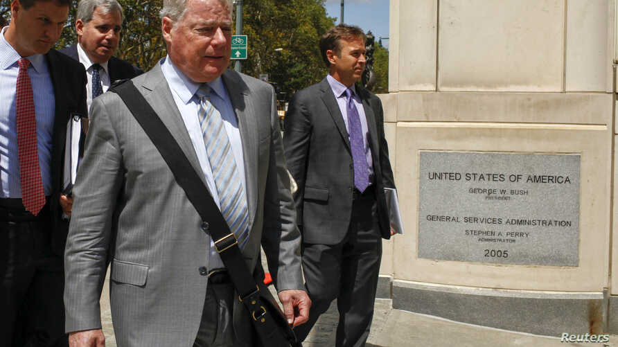 FILE - Shand Stephens (2nd R), a lawyer for Arab Bank Plc, exits the Brooklyn Federal Court in Brooklyn, New York, Aug. 14, 2014.