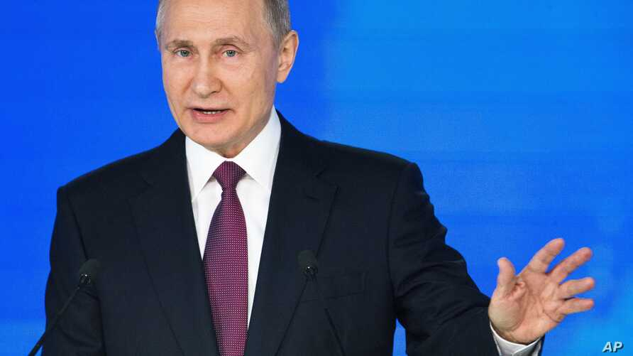 Russian President Vladimir Putin gestures as he gives his annual state of the nation address in Manezh in Moscow, Russia,  March 1, 2018.