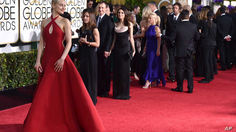 Actress Taylor Schilling arrives at the 72nd annual Golden Globe Awards at the Beverly Hilton Hotel Jan. 11, 2015, in Beverly Hills, California.