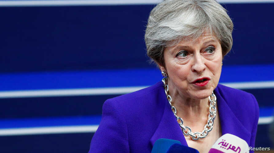 Britain's Prime Minister Theresa May speaks to the media as she arrives at the European Union leaders summit in Brussels, Belgium, Oct. 18, 2018.