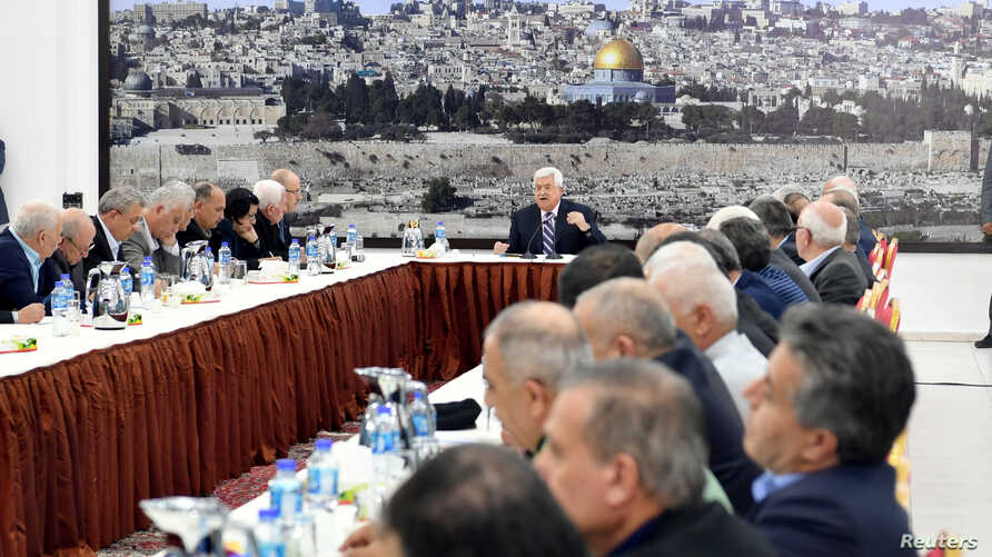 Palestinian President Mahmoud Abbas gestures as he speaks during a meeting with the Palestinian leadership in Ramallah, in the occupied West Bank, March 19, 2018.