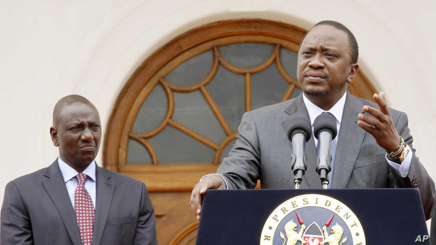 Kenya's President Uhuru Kenyatta, right, accompanied by Deputy President William Ruto, left, speaks to the media about the upcoming visit of U.S. President Barack Obama, among other issues, at State House in Nairobi, Kenya, July 21, 2015.
