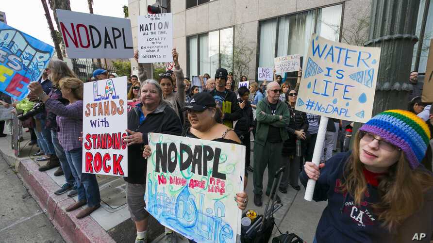 Opponents of the Dakota Access pipeline join protestors around the country, in response to the Army Corps of Engineers saying it will clear the way for completion of the disputed $3.8 billion project to carry North Dakota oil to Illinois, outside the
